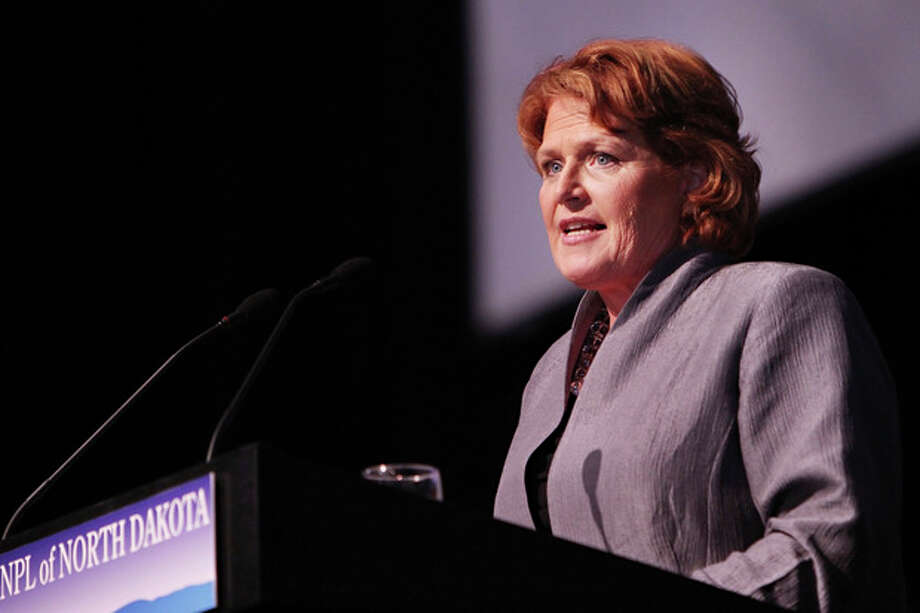 FILE - In this March 17, 2012 file photo, Heidi Heitkamp, the North Dakota Democratic Party's endorsed candidate for the U.S. Senate, speaks to delegates at the North Dakota Democratic state convention in Grand Forks, N.D. The constitutional win for President Barack Obama and Democrats on health care overhaul is reopening political cuts within the party over the unpopular law. Vulnerable Democratic incumbents and candidates, including Heitkamp, cautiously welcomed the court's judgment but argued that the law could be improved. (AP Photo/Shawna Noel Widdel, File) / AP2012