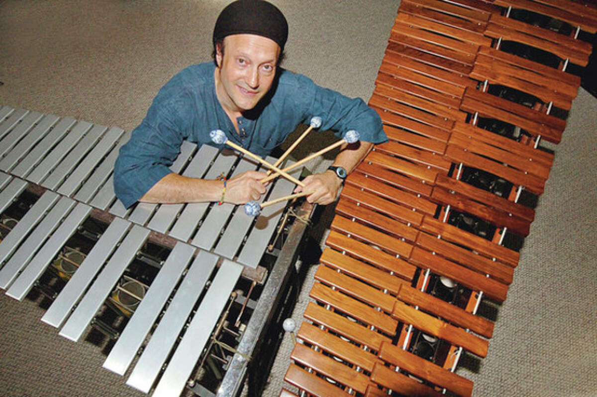 """Marimba player and Wilton resident Arthur Lipner has helped produce the upcoming documentray film """" Taliking Stcks"""" which he will discuss at the Unitarian Church in Westport Sunday July 8th. Hour photo / Erik Trautmann"""