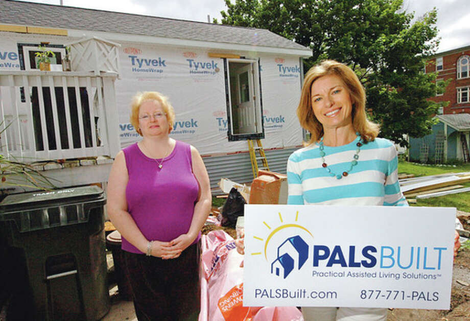 Hour photo / Erik TrautmannWilton resident Alison Rhodes, right, is the founder of PALS Built and has contracted with Danbury resident Pamela Murphy, left, to add a handicap-accessible modular to her home, so that Murphy can care for her elderly father-in-law. / (C)2012, The Hour Newspapers, all rights reserved