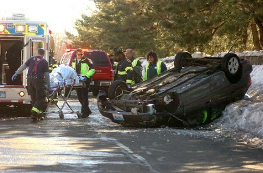 Photo/Alex von kleydorff. Scene of a one car roll over on Calf Pasture Beach Rd on Thursday at about 1pm