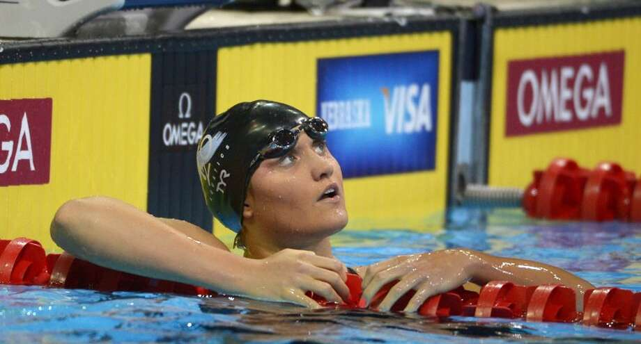 Elizabeth Pelton looks at the clock after swimming in the women's 200-meter backstroke final at the U.S. Olympic swimming trials, Saturday, June 30, 2012, in Omaha, Neb. (AP Photo/Mark J. Terrill)