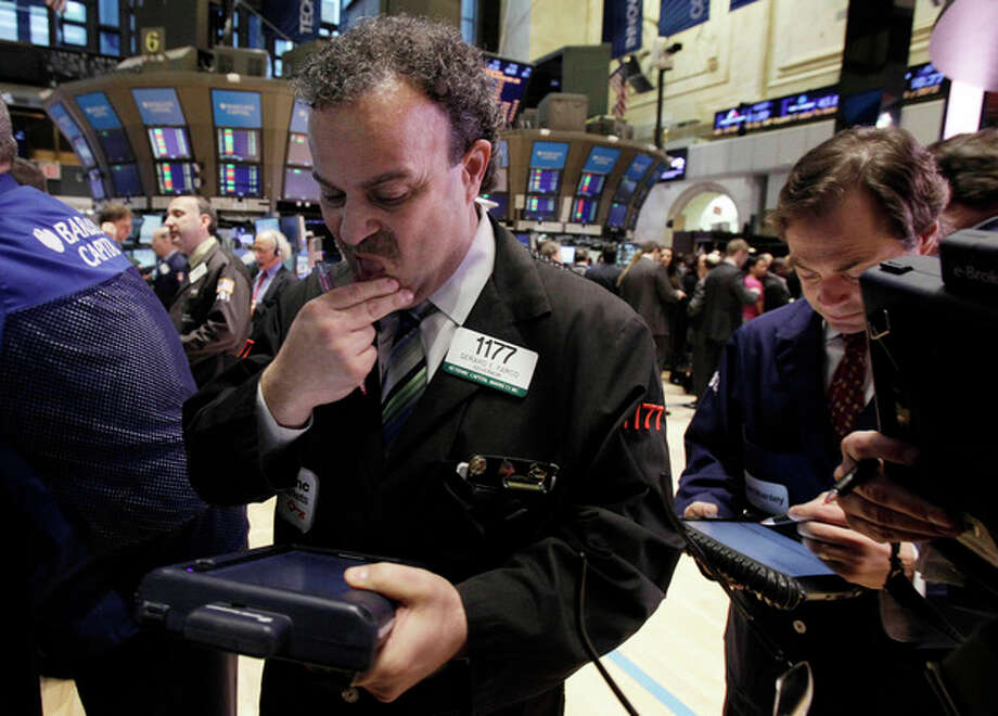 Traders Gerard Farco, left, and Dudley Devine work on the floor of the New York Stock Exchange Tuesday, March 13, 2012. Strong February retail sales results drove U.S. stocks higher at the opening of trading. (AP Photo/Richard Drew) / AP