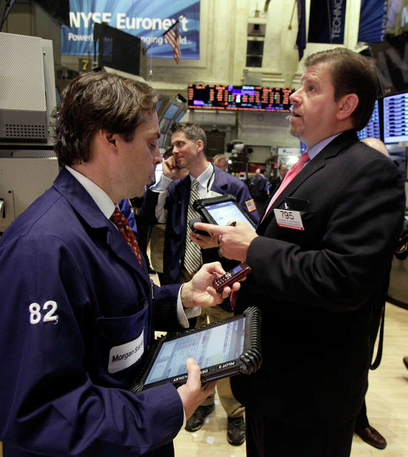Traders work on the floor of the New York Exchange Tuesday, March 13, 2012. Strong February retail sales results drove U.S. stocks higher at the opening of trading. (AP Photo/Richard Drew) / AP