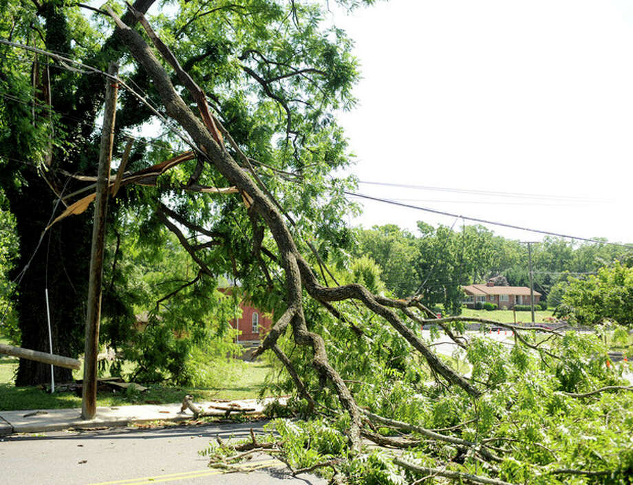 A tree fell on a power line on Thornrose Avenue near Gypsy Hill Park on Saturday, June 30, 2012 in Staunton, Va. Violent storms swept across the eastern U.S., killing at least nine people and knocking out power to hundreds of thousands on a day that temperatures across the region are expected to reach triple-digits. (AP Photo/The News Leader, Pat Jarrett) / The News Leader