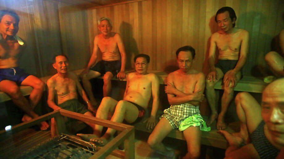 In this photo taken on March 18, 2013, patients sit in a sauna room at the Scientology health center of Vietnam Association of Agent Orange Victims in Thai Binh city, Vietnam. The center runs a 25-day health program which, as well as massive consumption of vitamins, includes four-hour sauna sessions and a morning run. While there is no medical evidence that the treatment at the center is effective, Vietnamese authorities are supporting it as a way of relieving some of the suffering of the between 2 and 4 million people suffering from illnesses linked to exposure to Agent Orange during the war. (AP Photo/Na Son Nguyen) / AP