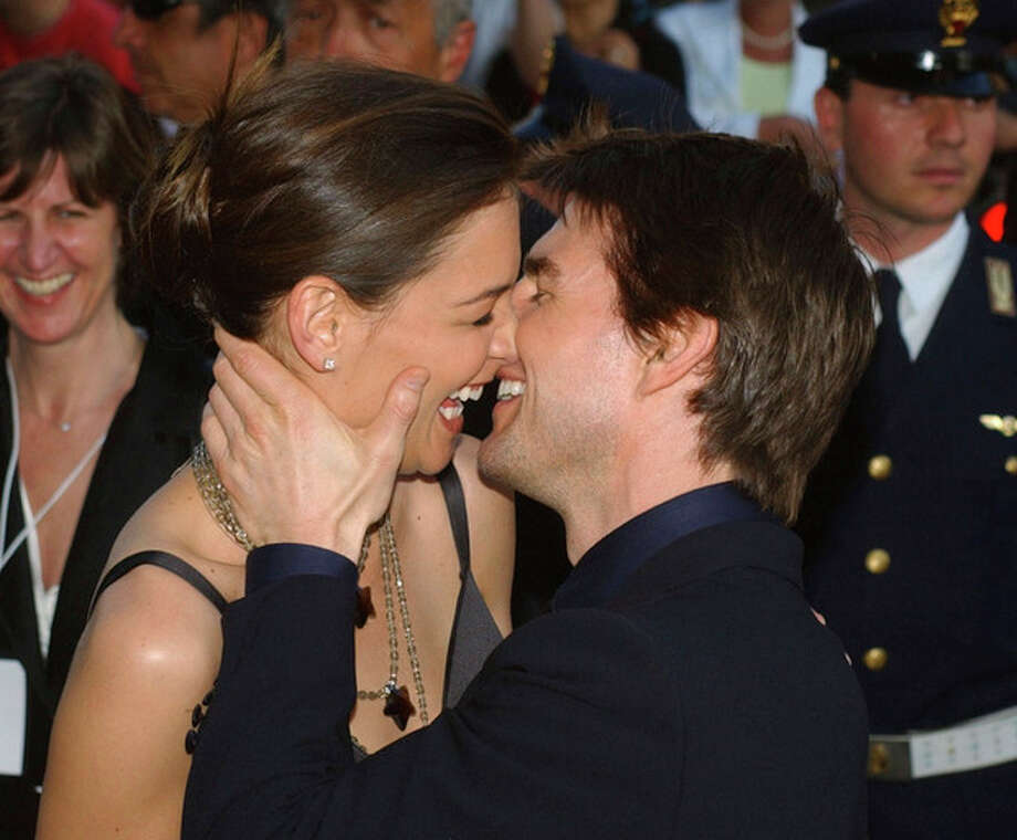 FILE - In this Friday April 29, 2005 file photo,Tom Cruise, right, and Katie Holmes laugh as they on Via della Conciliazione Boulevard near St. Peter's Basilica, as they arrive at the St. Cecilia auditorium for the David di Donatello Italian film awards, in Rome. Holmes' attorney Jonathan Wolfe said Friday June 29, 2012 that the couple is divorcing, but called it a private matter for the family. (AP Photo/Corrado Giambalvo, File) / AP2005