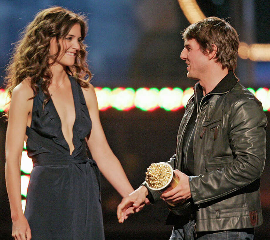 FILE - In this Saturday, June 4, 2005 file photo, Tom Cruise, right, reaches for the hand of his girlfriend Katie Holmes after accepting the MTV Generation award, during the MTV Movie Awards, in Los Angeles. Cruise and Homes are calling it quits after five years of marriage. Holmes' attorney Jonathan Wolfe said Friday June 29, 2012 that the couple is divorcing, but called it a private matter for the family. (AP Photo/Mark J. Terrill, File) / AP2005