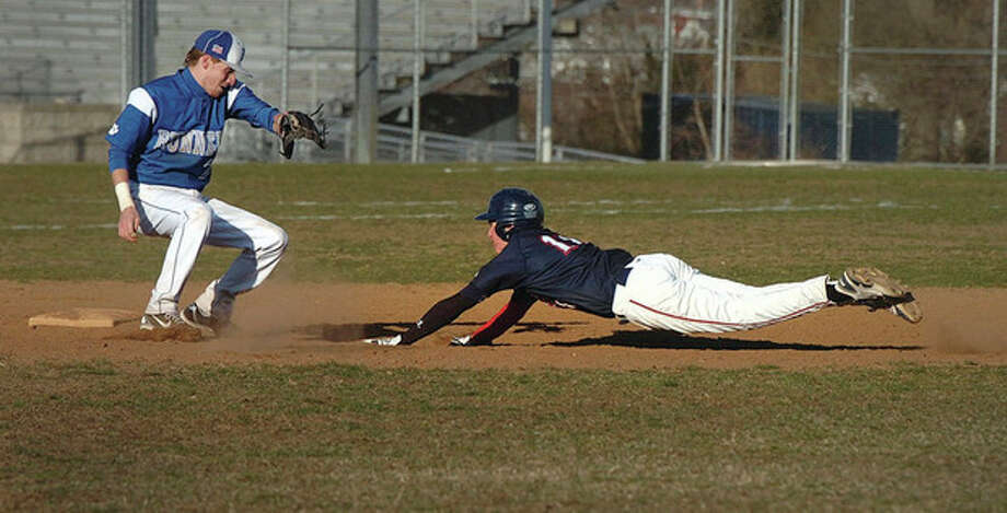 Hour Photo/Alex von KleydorffBrien McMahon's Andrew Seiden slides safely into second with a stolen base as Bunnell's Cameron Belliveau gets ready to apply the tag during the sixth inning of Wednesday's game. Seiden eventually scored. The Senators claimed an 8-0 victory. / 2013 The Hour Newspapers