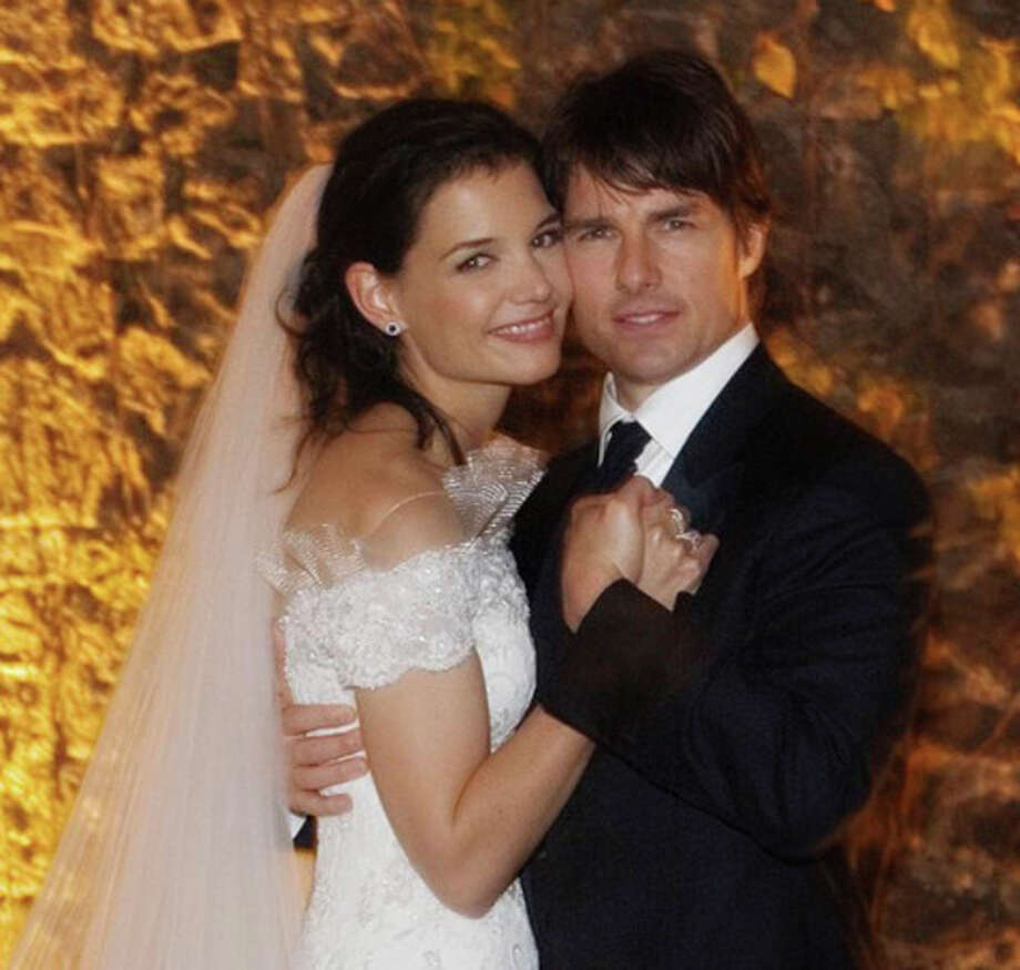 FILE - In this Nov. 18, 2006 file photo released by Rogers and Cowan, actor Tom Cruise and actress Katie Holmes pose in their wedding attire at the 15th-century Odescalchi Castle overlooking Lake Bracciano outside of Rome. Cruise and Homes are calling it quits after five years of marriage. Holmes' attorney Jonathan Wolfe said Friday June 29, 2012 that the couple is divorcing, but called it a private matter for the family. (AP Photo/Robert Evans, File) / AP2006