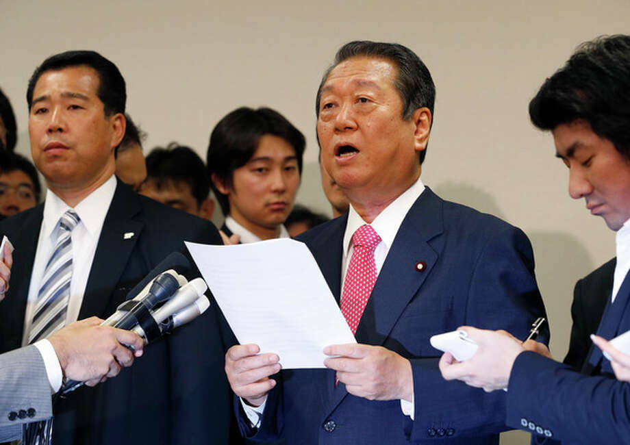 Lower House Parliament member Ichiro Ozawa reads a statement during a press conference in Tokyo, Monday, July 2, 2012. Ozawa and 49 other lawmakers submitted their resignations to the Democratic Party of Japan and others could leave later, a party official said. (AP Photo/Shizuo Kambayashi) / AP