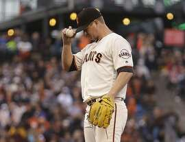 San Francisco Giants pitcher Matt Cain adjusts his cap during the third inning of a baseball game against the Milwaukee Brewers on Monday, June 13, 2016, in San Francisco. (AP Photo/Ben Margot)
