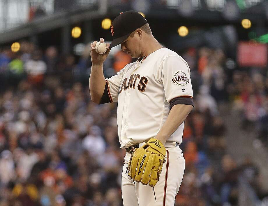 San Francisco Giants pitcher Matt Cain adjusts his cap during the third inning of a baseball game against the Milwaukee Brewers on Monday, June 13, 2016, in San Francisco. (AP Photo/Ben Margot) Photo: Ben Margot, Associated Press