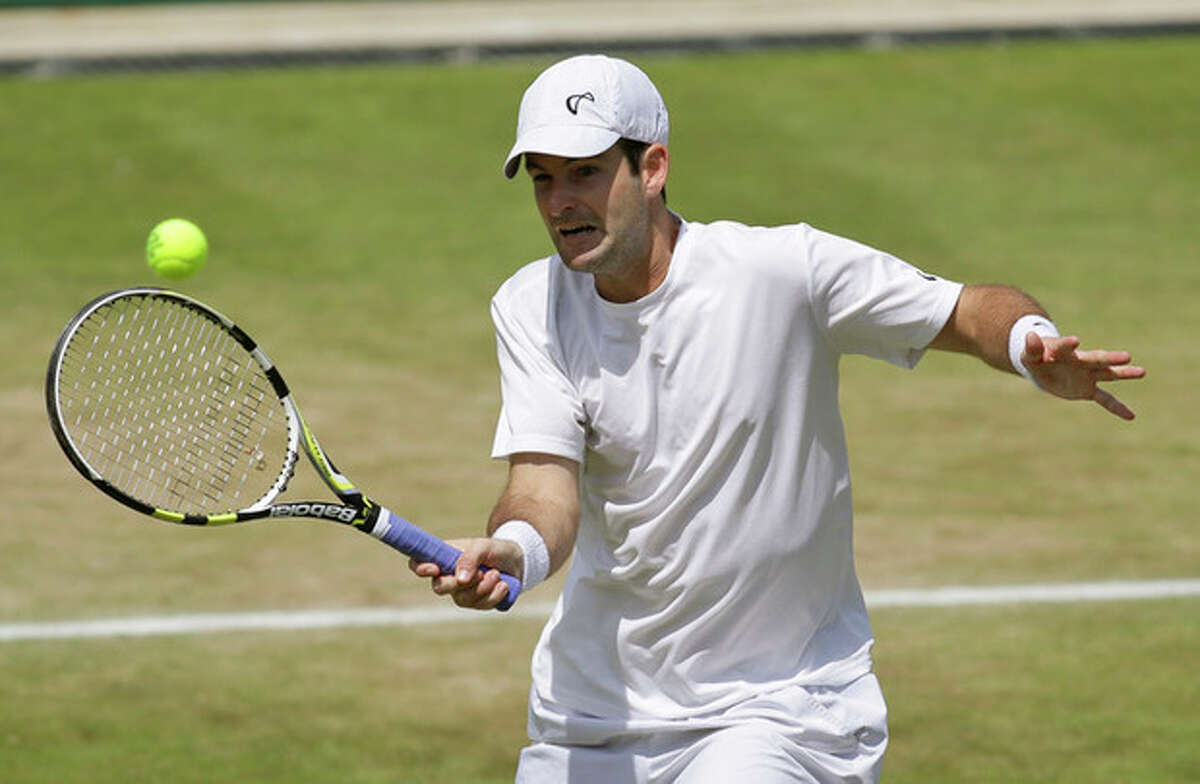 Brian Baker of the United States returns a shot against Benoit Pare of France during a second round men's singles match at the All England Lawn Tennis Championships at Wimbledon, England, Saturday, June 30, 2012. (AP Photo/Sang Tan)