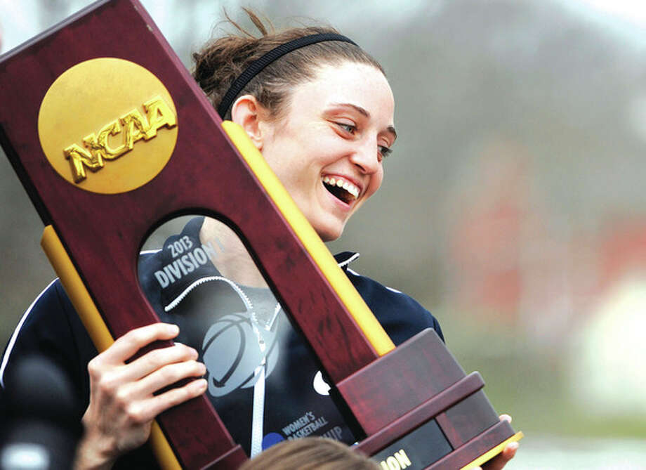 AP photoKelly Faris holds the championship trophy during Wednesday's parade through the UConn campus honoring the team's for its win over Louisville in the NCAA women's national championship game. It was the eighth national championship for the Huskies. / FR125654 AP