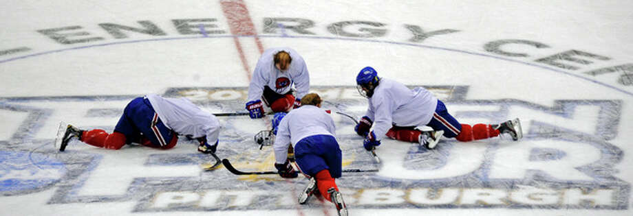 UMass Lowell players stretch during an NCAA college hockey practice at the Consol Energy Center, Wednesday, April 10, 2013, in Pittsburgh. UMass Lowell is scheduled to play Yale Thursday in a Frozen Four semifinal. (AP Photo/Pittsburgh Post-Gazette, Matt Freed) MAGS OUT; NO SALES; MONESSEN OUT; KITTANNING OUT; CONNELLSVILLE OUT; GREENSBURG OUT; TARENTUM OUT; NORTH HILLS NEWS RECORD OUT; BUTLER OUT / Pittsburgh Post-Gazette