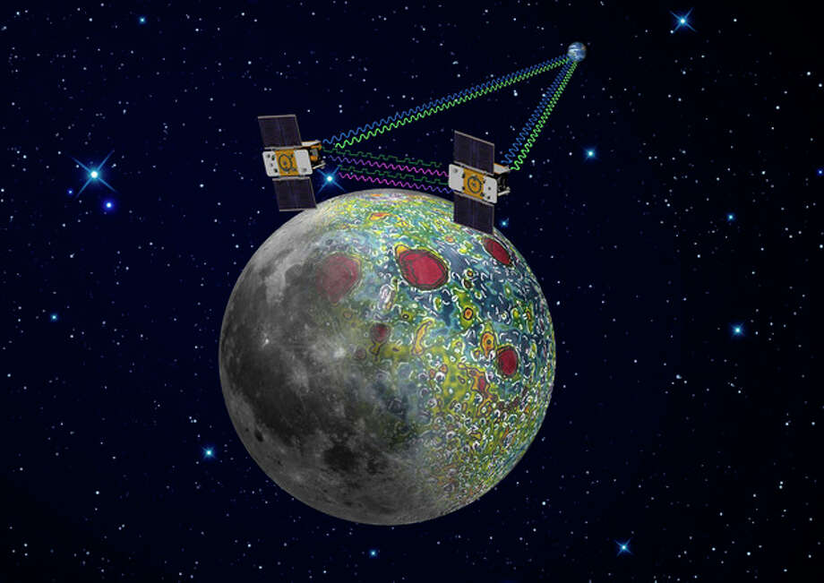 This undated artist rendering provided by NASA on Dec. 21,2011 shows the twin Grail spacecraft mapping the lunar gravity field. The two probes are scheduled to enter orbit around the moon over New Year's weekend. (AP Photo/NASA, Jet Propulsion Laboratory) / NASA/JPL