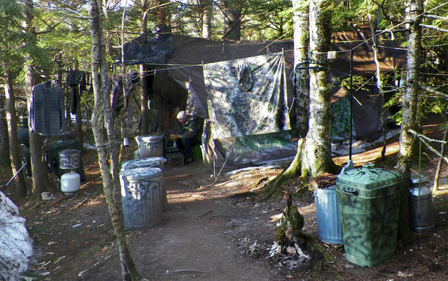 This photo released Wednesday, April 10, 2013 by the Maine Department of Public Safety shows a camp in a remote, section of Rome, Maine, where authorities believe Christopher Knight lived like a hermit for decades. Knight, known as the North Pond Hermit, was arrested Thursday, April 4, 2013, while stealing food from another camp in Rome. Authorities said he may be responsible for more than 1,000 burglaries. (AP Photo/Maine Department of Public Safety) / Maine Department of Public Safety