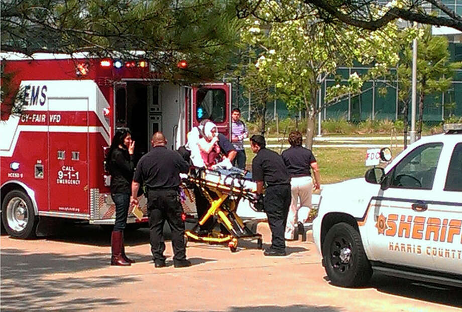 In this photo provided by Teaundrae Perryman, a victim is loaded into an ambulance after being wounded in a stabbing attack on the Lone Star community college system's Cypress, Texas campus Tuesday, April 9, 2013. At least 14 people were wounded when a suspect went building-to-building in an apparent stabbing attack at the college campus authorities said. (AP Photo/Teaundrae Perryman) / Teaundrae Perryman