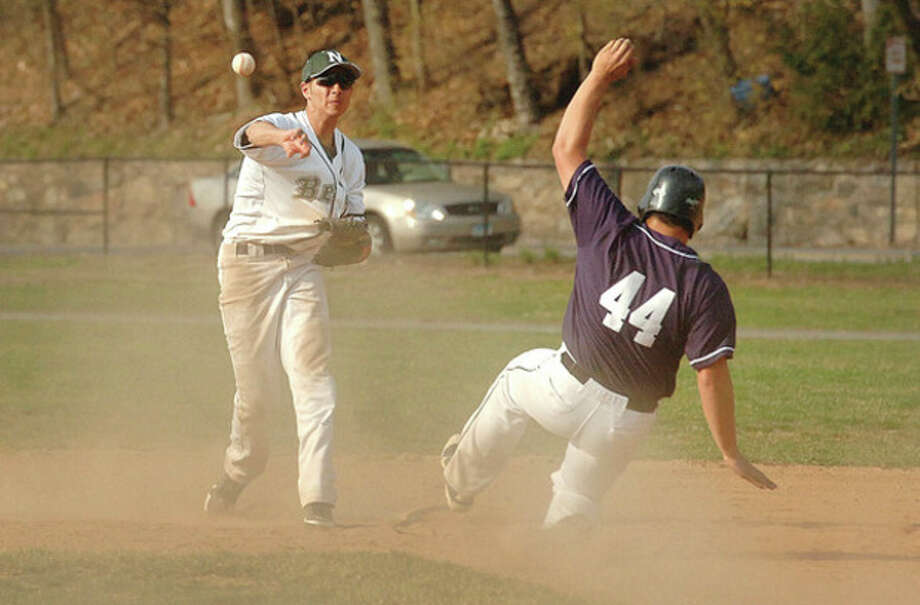 Hour photo/Alex von KleydorffNorwalk's Tyler Annunziata, left, fires to first after forcing Bryan Terzian of Staples at second during Wednesday's game at Mlmquist Field. Annunziata drove in the go-ahead run in the fifth inning of the Bears' 7-4 victory. / 2013 The Hour Newspapers