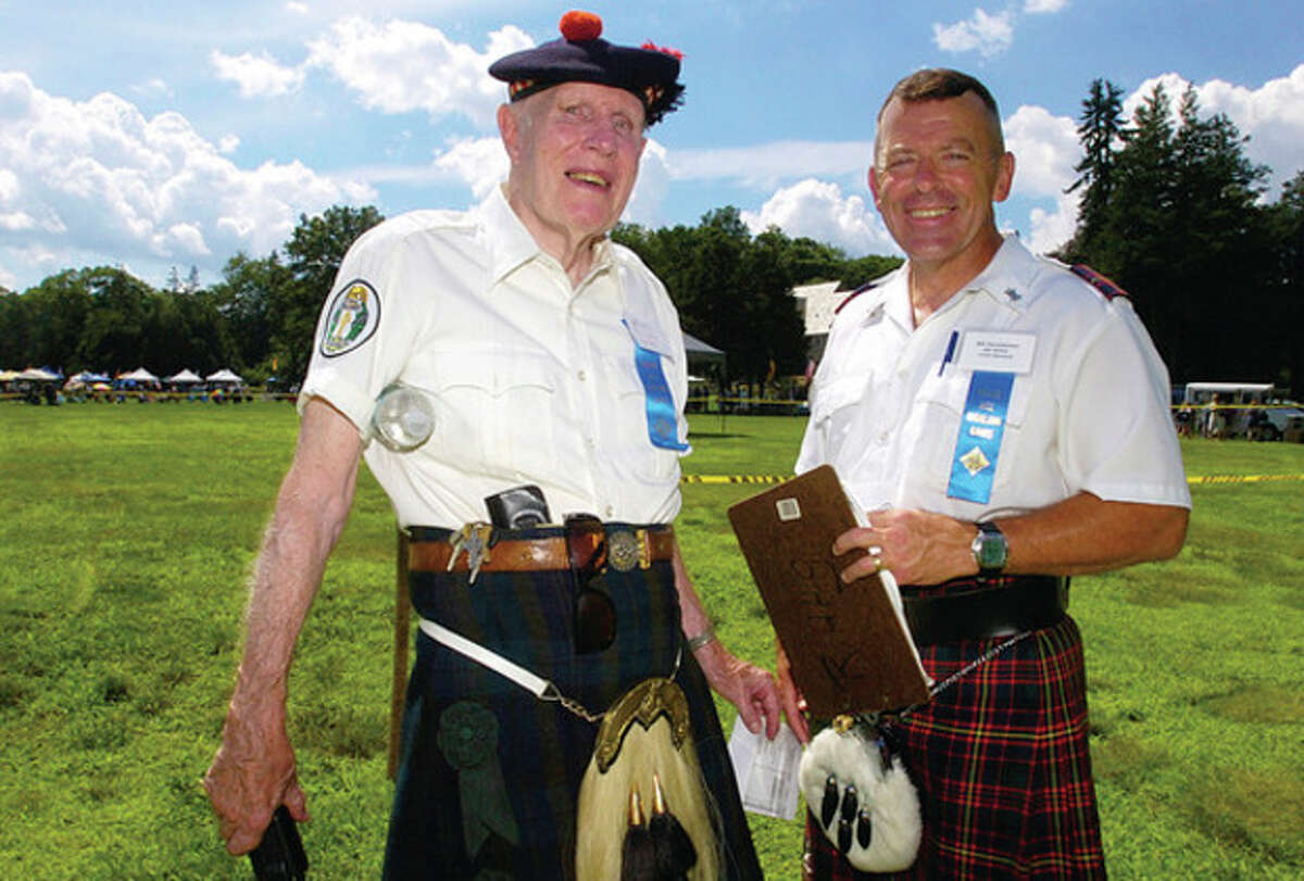 Steward and Chief Steward, Dick Crawford and Bill Hennessy await the Pipe Band Competition during the 88th Round Hill Highland Games at Cranbury Park Saturday.