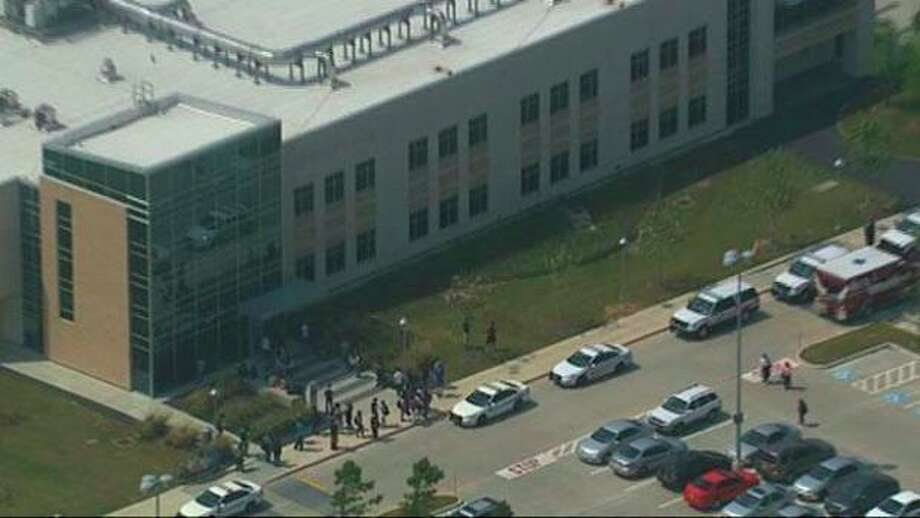 This frame grab provided by KTRK shows the scene above the Cy-Fair campus of Lone Star Community College in Cypress, Texas, where officials say about a dozen people have been wounded in a stabbing attack Tuesday, April 9, 2013. The Harris County Sheriff's department confirmed at least 11 people wounded and that authorities have one suspect in custody. (AP Photo/KTRK) / KTRK