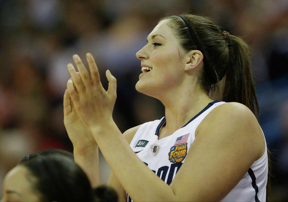 Connecticut center Stefanie Dolson (31) reacts from the bench during first half of the national championship game against Louisville of the women's Final Four of the NCAA college basketball tournament, Tuesday, April 9, 2013, in New Orleans. (AP Photo/Gerald Herbert) / AP