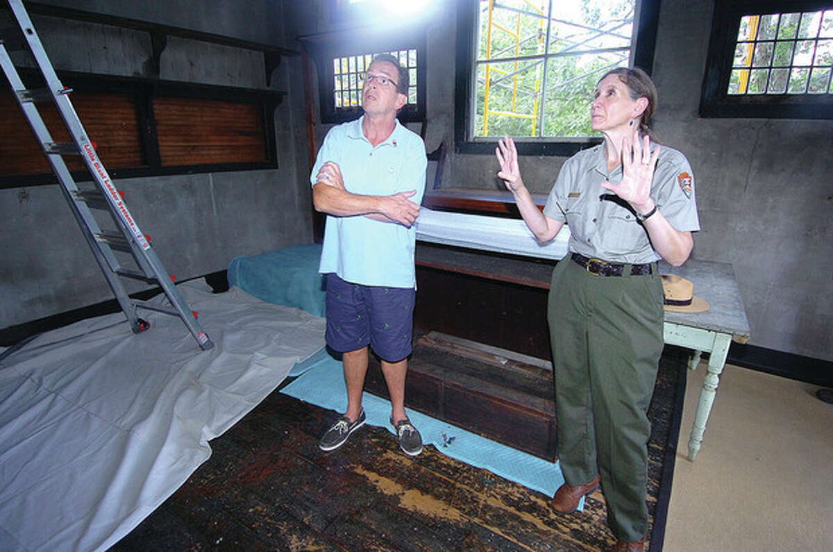 Hour Photo/ Alex von Kleydorff. Superintendent Linda Cook explains how the natural light falls into the Weir studio to Governor Dan Malloy during his visit to Weir Farm National Historic Site.