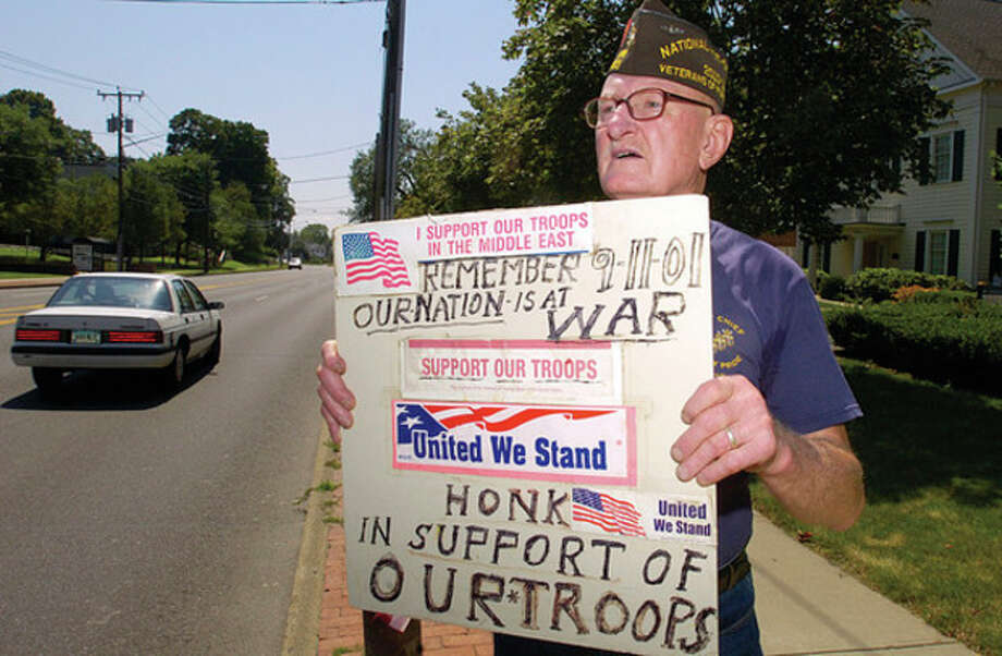 @White=[C] Hour photo / Erik Trautmann For the last decade, Norwalk veteran Don Burrows has stood along East Avenue opposite City Hall on most Saturdays and urged passing motorists to honk in support of American servicemen and women abroad. / (C)2011, The Hour Newspapers, all rights reserved