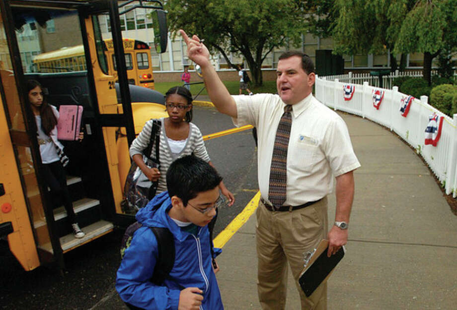 West Rocks Middle School Assistant Principal Joe Devellis directs students to their home rooms on the first day of school Tuesday. / (C)2011, The Hour Newspapers, all rights reserved