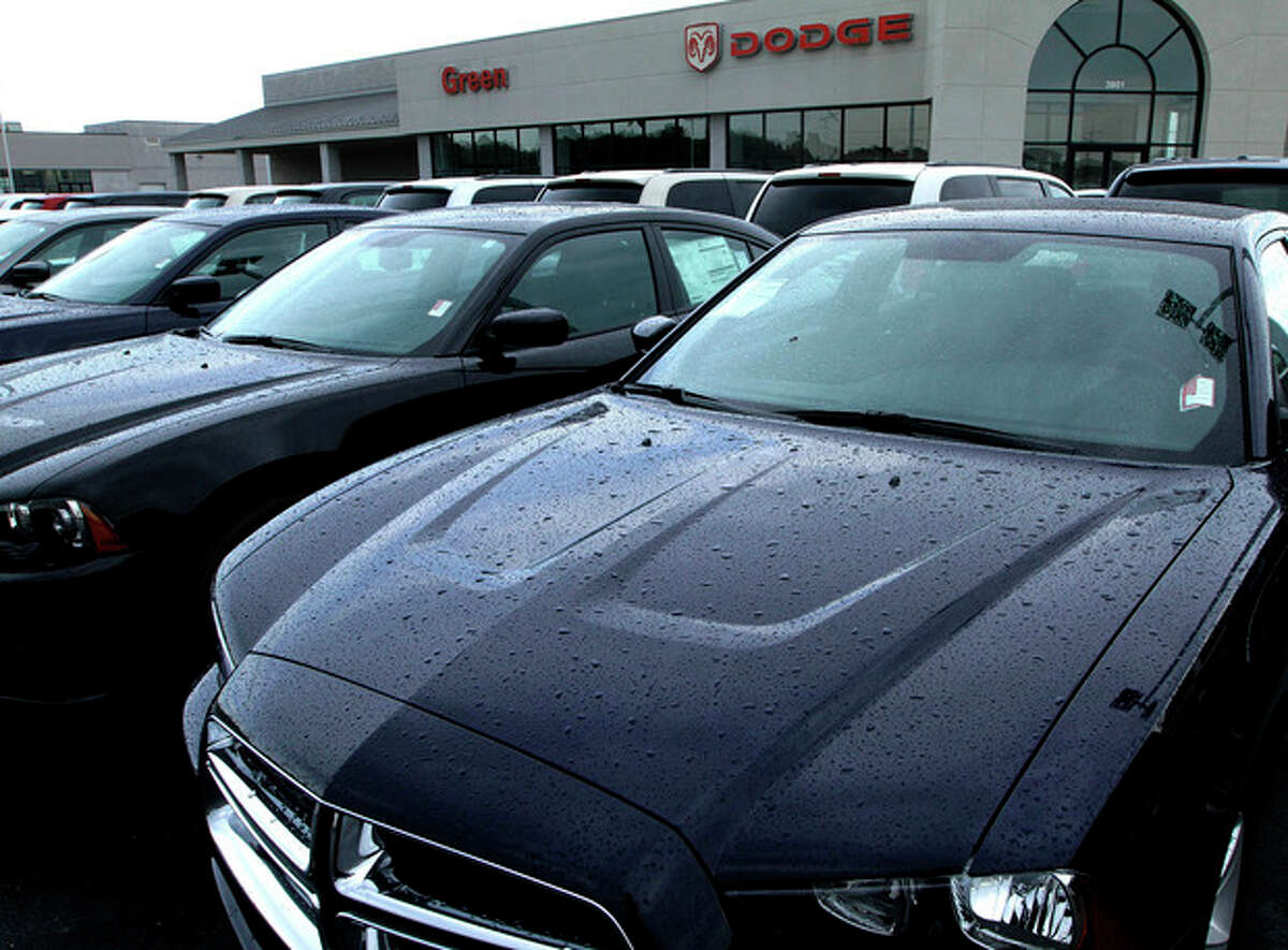 FILE- In this Sunday, June 24, 2012, file photo Dodge cars are for sale at an auto dealership in Springfield, Ill. Chrysler reported Tuesday, July 3, 2012, that U.S. sales rose 20 percent, its best June in five years, thanks to demand across its lineup (AP Photo/Seth Perlman, File)