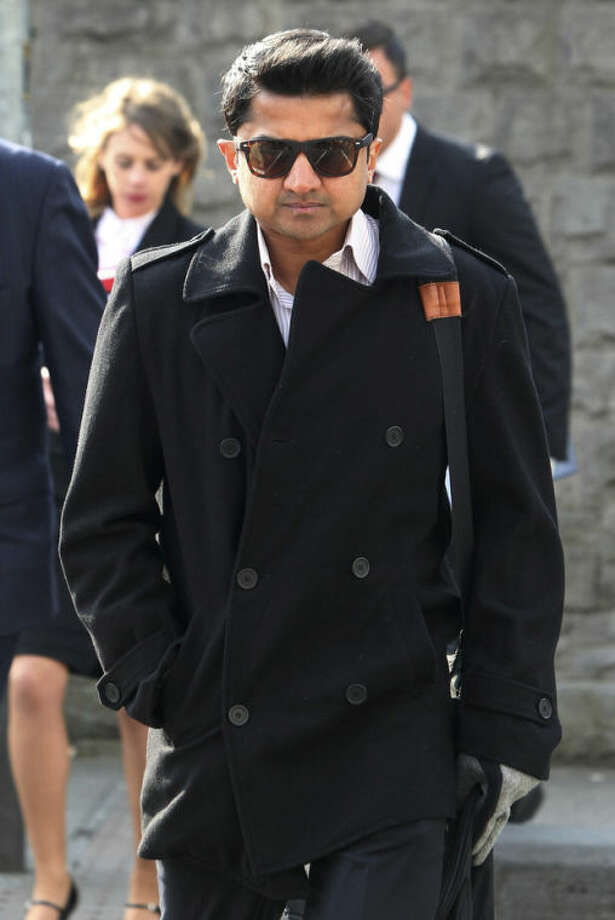 Praveen Halappanavar, the husband of Savita Halappanavar arrives for the inquest into her death at Galway Coroners court. in Ga;way Ireland Monday April 8, 2013. Savita Halappanavar was 17 weeks pregnant when she was admitted to University Hospital Galway on Oct. 21 last year and died a week later from suspected septicaemia, days after she lost her baby. The 31-year-old's widower Praveen maintains the couple repeatedly requested a termination but were refused because the foetal heartbeat was present. (AP Photo/ Niall Carson/PA) UNITED KINGDOM OUT NO SALES NO ARCHIVE
