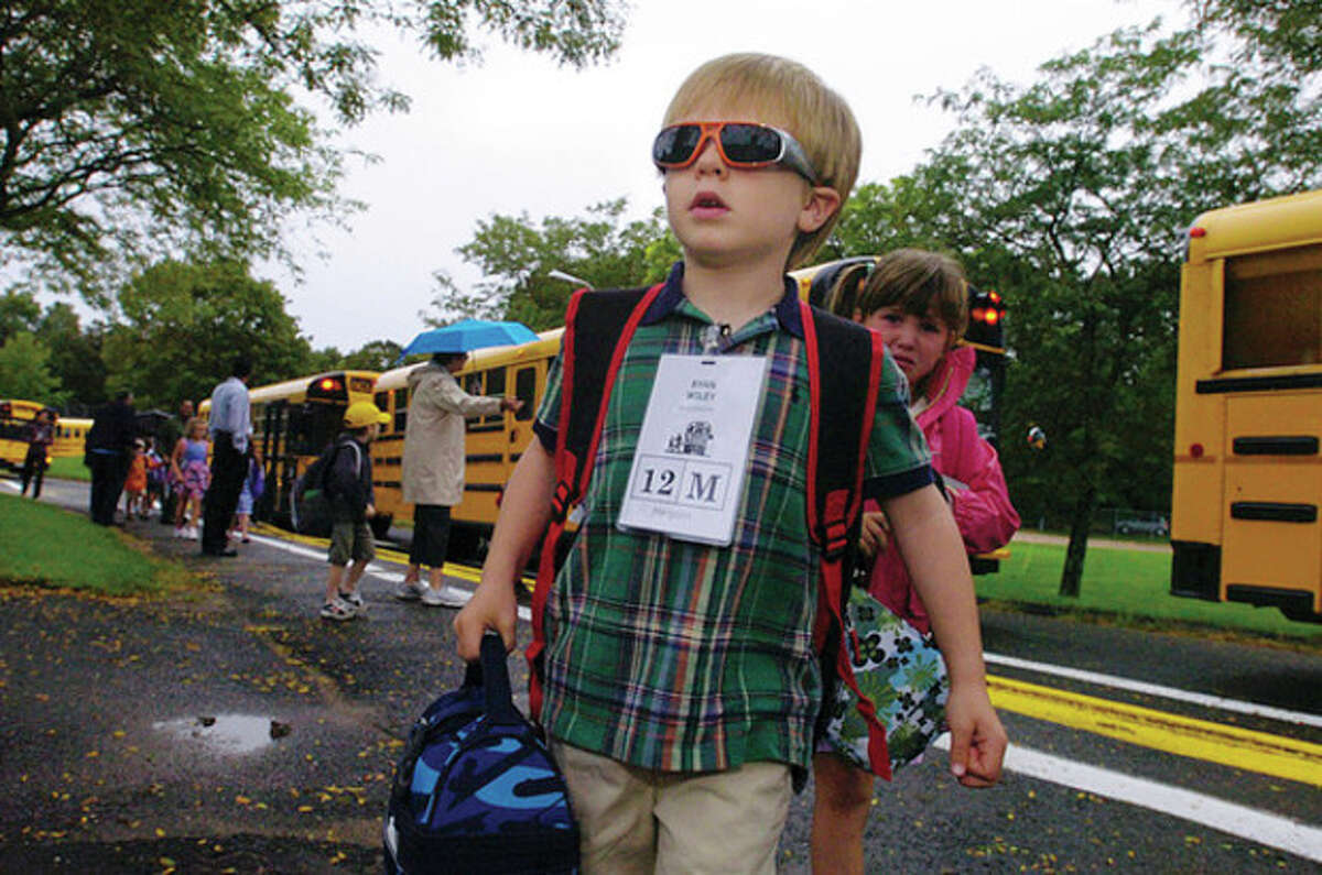 Miller Driscoll School kindergartner Ryan Wiley is prepared for a bright future on the first day of school Tuesday. Hour photo / Erik Trautmann