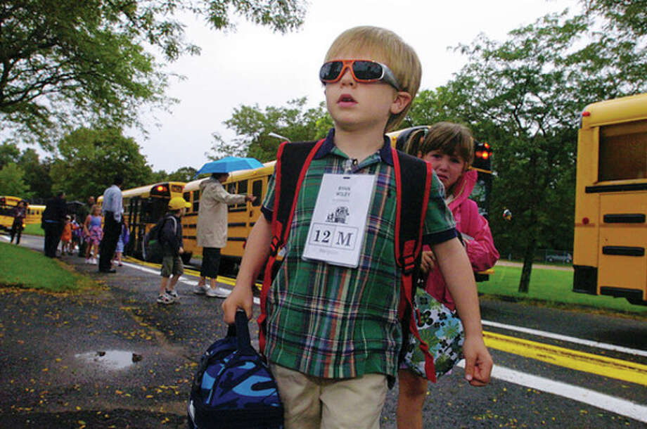 Miller Driscoll School kindergartner Ryan Wiley is prepared for a bright future on the first day of school Tuesday. Hour photo / Erik Trautmann / (C)2011, The Hour Newspapers, all rights reserved