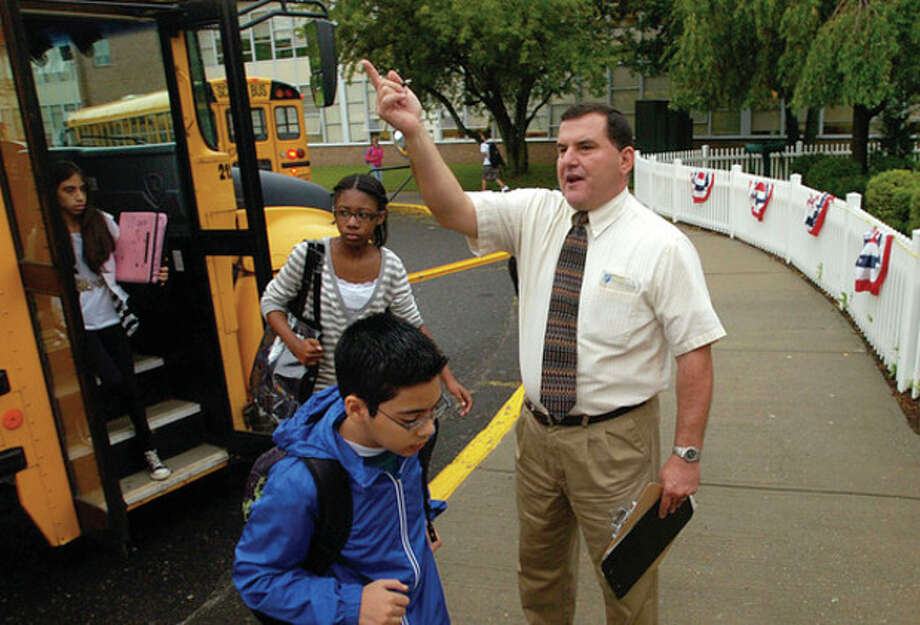 West Rocks Middle School Assistant Principal Joe Devellis directs students to their home rooms on the first day of school. / (C)2011, The Hour Newspapers, all rights reserved