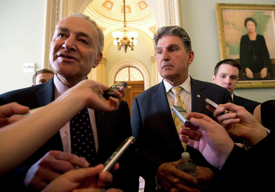 Sens. Chuck Schumer, D-N.Y., left, and Joe Manchin, D-W.Va. speak to reporters as they walk from Senate Majority Leader Harry Reid's, D-Nev., office on Capitol Hill in Washington, Tuesday, April 9, 2013, after a meeting on gun control. Reid's determination to stage a vote came despite continued inconclusive talks between Manchin, Sen. Patrick Toomey, R-Pa., aimed at finding compromise on expanding background checks to more gun purchasers. But Manchin left a meeting in Reid's office late Tuesday and said he hoped a deal could be completed on Wednesday. (AP Photo/Manuel Balce Ceneta) / AP