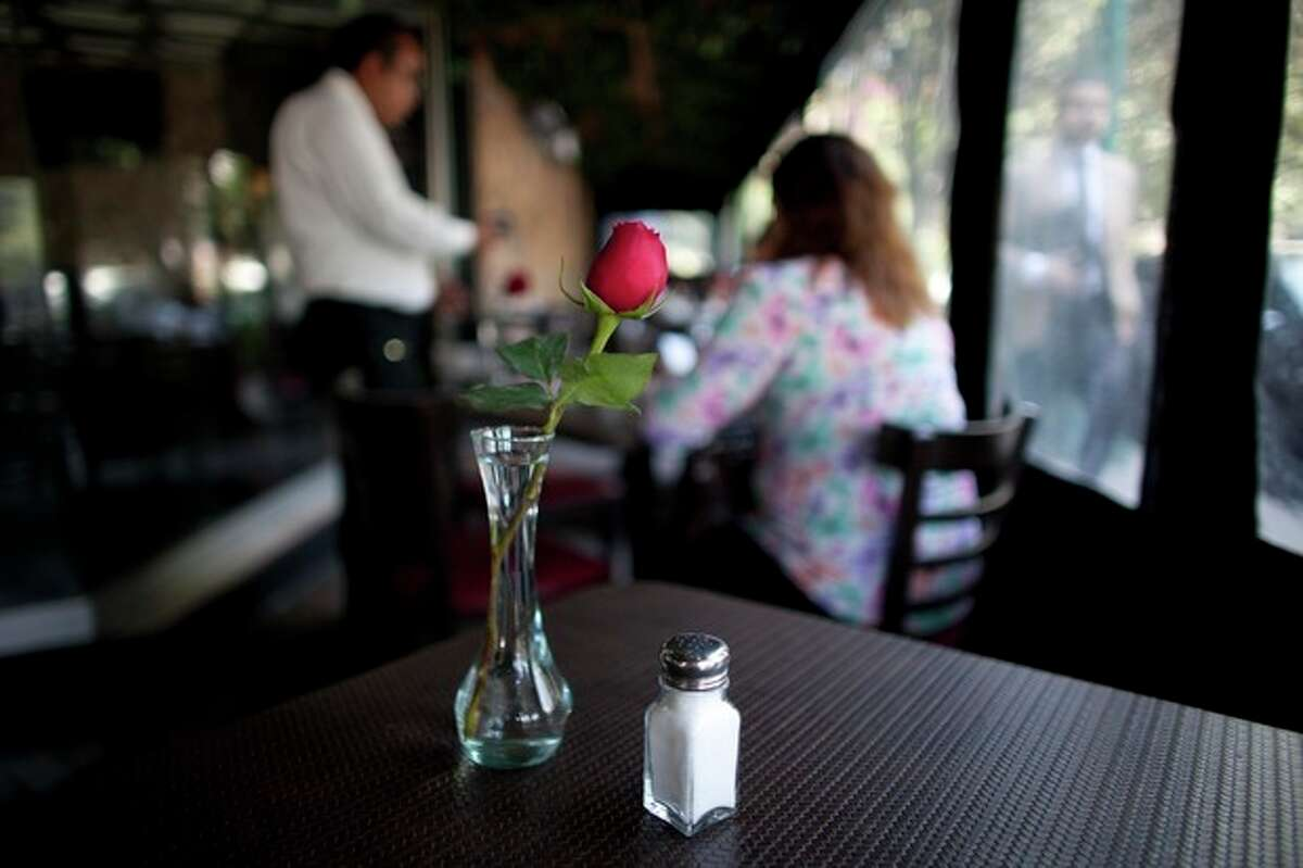 """In this April 9, 2013 photo, a salt shaker sits on a table in a restaurant in Mexico City. The country's Health Secretary Armando Ahued launched a campaign, dubbed ?""""Less Salt, More Health,?"""" to get restaurants to take salt shakers off their tables. Officials and the city?'s restaurant chamber signed an agreement to encourage eateries to provide shakers only if guests ask for them. The program is voluntary but the chamber is urging its members to comply. (AP Photo/Alexandre Meneghini)"""