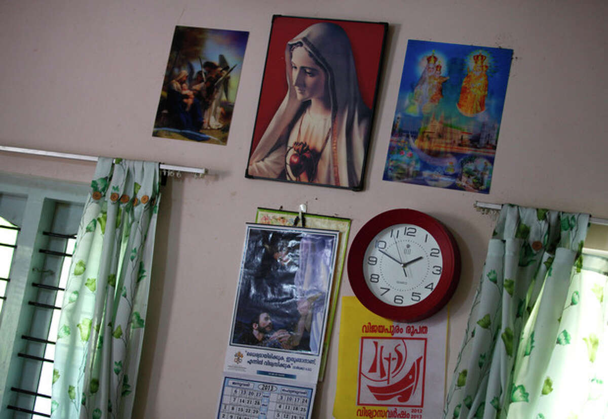"""ADVANCE FOR USE SUNDAY, APRIL 14, 2013 AND THEREAFTER - In this Feb. 24, 2013 photograph, a portrait of Virgin Mary, center, hangs on the wall of a rape victim, the """"Suryanelli girl,"""" in Kottayam, India. The government recorded 24,206 rapes in 2011. With a population of almost 1.2 billion, India?'s official number of rapes per capita does not stand out. However, the vast majority of attacks go unreported because of police apathy and cultural stigma. (AP Photo/Aijaz Rahi)"""