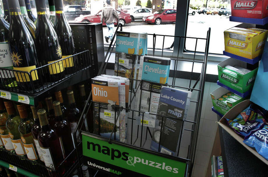 In this Monday, April 9, 2012 photo a scant rack of road maps is seen at a gas station/mini mart in Solon, Ohio on. Colorful maps bearing the logos of the oil companies that printed them _ names like Texaco, Gulf, Esso _ once brimmed from displays at filling stations, free for the taking. (AP Photo/Amy Sancetta) / AP