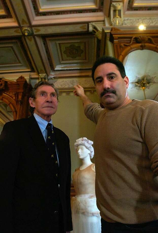 Norwalk Historical Commission Chairman Peter Bondi and Lockwood Mathews Mansion Museum Executive Director Sheldon Gerarden point out damage to the ceiling done by the leaking roof at the mansion. Hour photo / Erik Trautmann