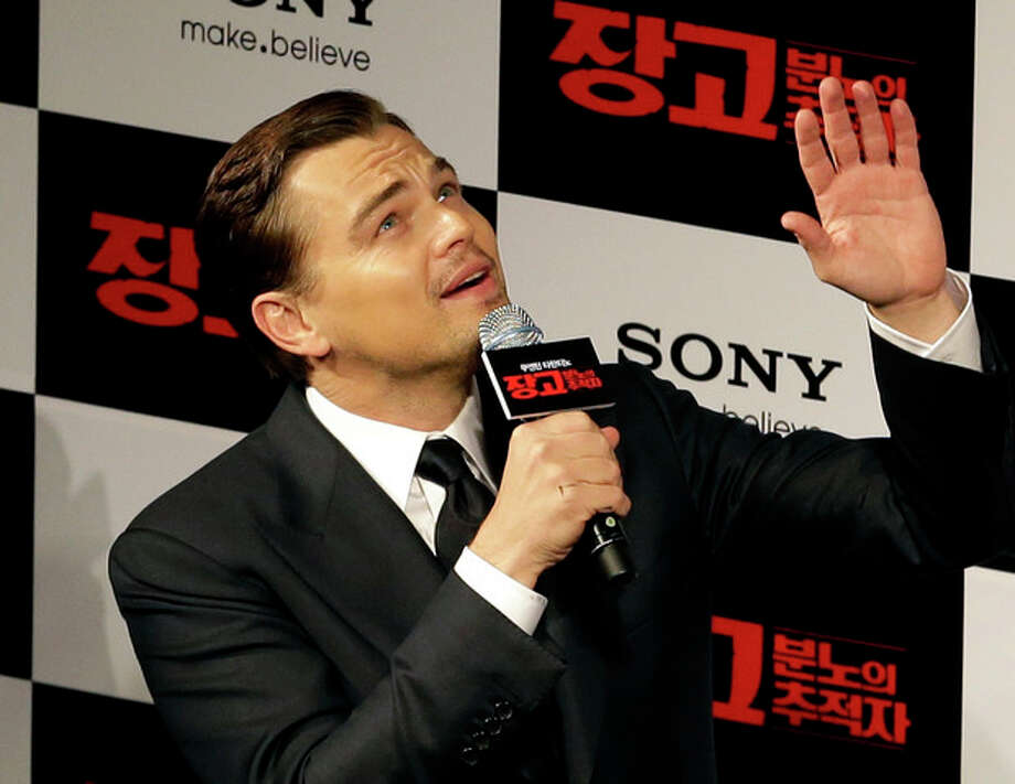 """FILE - In this Thursday, March 7, 2013 file photo, actor Leonardo DiCaprio waves to fans upon arrival for a premiere of his new film """"Django Unchained"""" in Seoul, South Korea. The Hollywood film """"Django Unchained"""" has been pulled from Chinese theaters on its opening day, despite weeks of promotion for director Quentin Tarantino's violent slave-revenge saga. Movie theaters throughout China said Thursday, April 11, 2013 that they were ordered to suspend the film. (AP Photo/Lee Jin-man, File) / AP"""