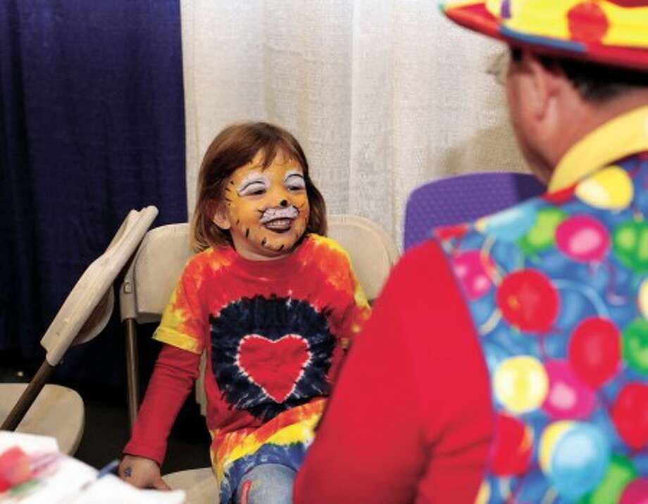 Chelsea Britz, 4, smiles after looking at her face paint during Kid''s Fest to benefit the Norwalk Hospital inside the Wilton High School Field House Sunday morning. Hour Photo / Danielle Robindon