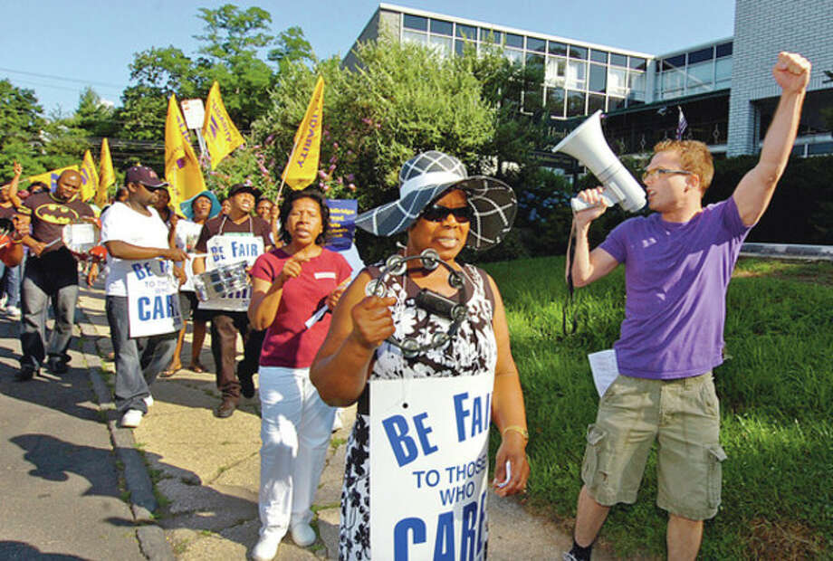 HealthBridge employees and members of Local 1190 of the Service Employees International Union (SEIU) picket outside Healthbridge at Burr St and route 1 in Westport in response to terminated contract negotiations.Hour photo / Erik Trautmann / (C)2012, The Hour Newspapers, all rights reserved