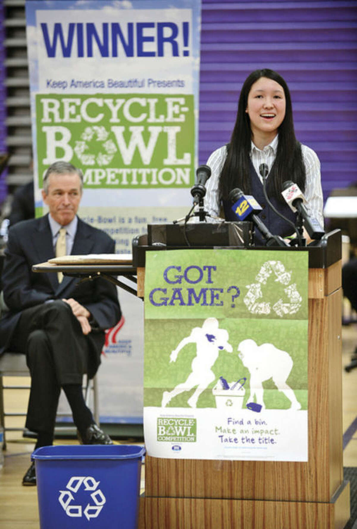 Stamford's Westhill High School senior and Co-president of the school's enviromental club, Eco-Heroes, speaks as the the school holds an award ceremony for their Keep America Beautiful Recycling Bowl win. The high school recycled 3.56 pounds of waste per student, the best of the 28 schools in the state of Connecticut. Hour photo / Erik Trautmann