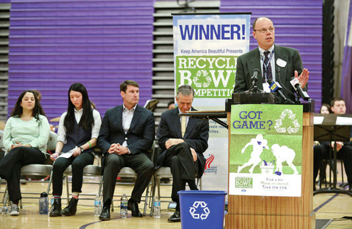 City of Stamford Supervisor of Solid Waste/Recycling, Dan Colleluori, speaks as Stamford's Westhill High School holds an award ceremony for their Keep America Beautiful Recycling Bowl win. The high school recycled 3.56 pounds of waste per student, the best of the 28 schools in the state of Connecticut. Hour photo / Erik Trautmann