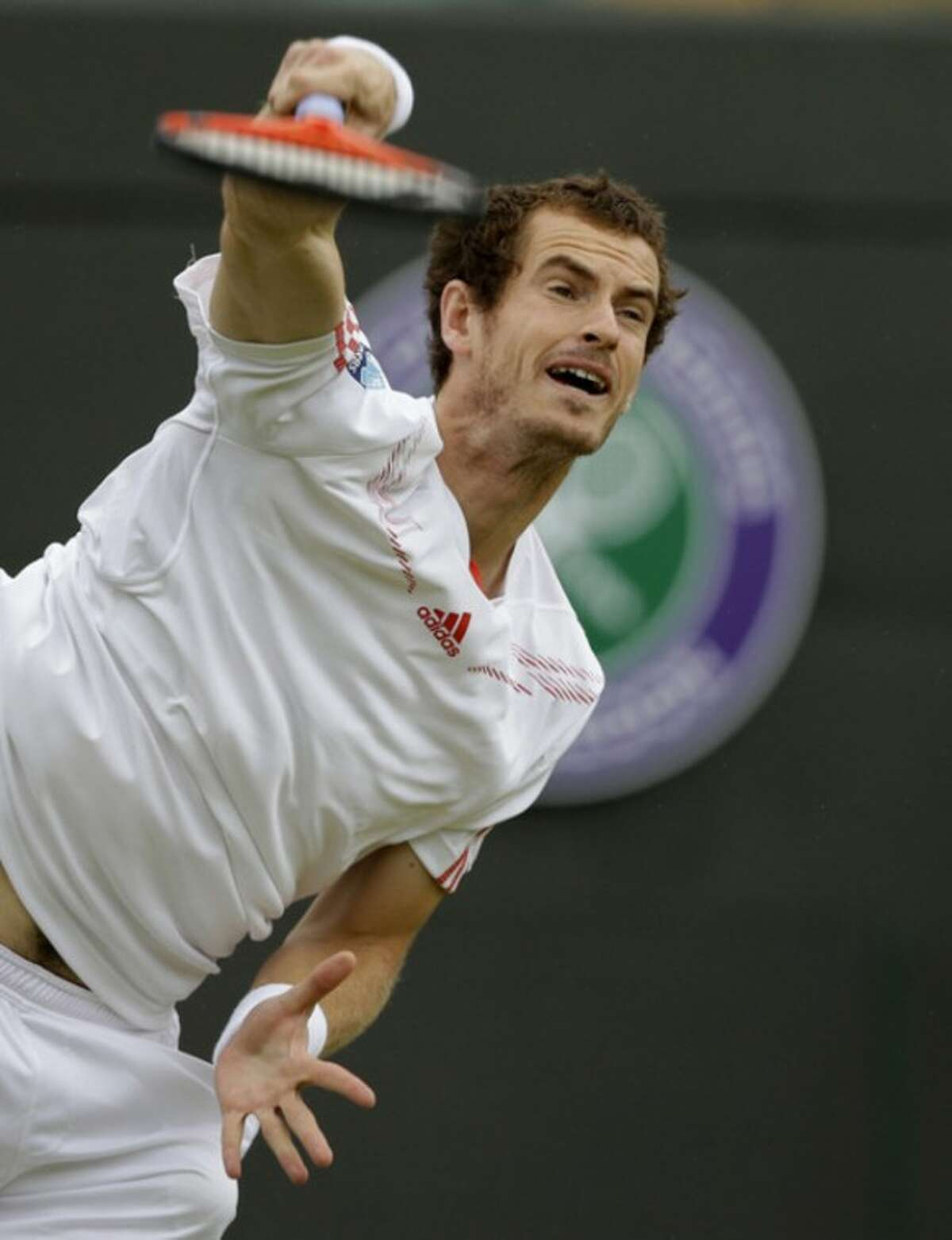 Andy Murray of Britain serves to Marin Cilic of Croatia during a fourth round singles match at the All England Lawn Tennis Championships at Wimbledon, England, Tuesday, July 3, 2012. (AP Photo/Kirsty Wigglesworth)