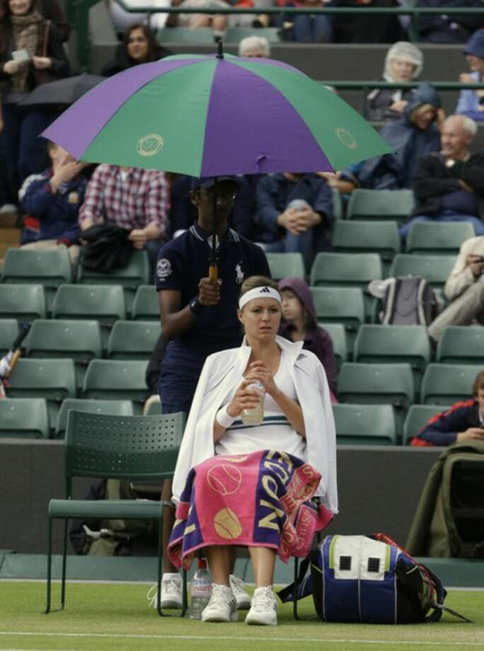 Maria Kirilenko of Russia waits as rain delays play during a quarterfinals match against Agnieszka Radwanska of Poland at the All England Lawn Tennis Championships at Wimbledon, England, Tuesday, July 3, 2012. (AP Photo/Kirsty Wigglesworth)