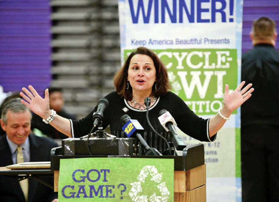 """Hour photos / Erik TrautmannAbove, Stamford's Westhill High School Principal Camille Figluzzi speaks as the school holds an award ceremony for its """"Keep America Beautiful Recycling Bowl"""" win. The high school recycled 3.56 pounds of waste per student, the best of the 28 schools in the state of Connecticut. Below, City of Stamford supervisor of Solid Waste/Recycling Dan Colleluori speaks. Bottom, Stamford's Westhill High School accepts a check from Keep America Beautiful. / (C)2013, The Hour Newspapers, all rights reserved"""