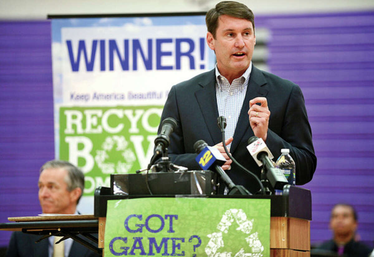 Netsle Waters CEO Tim Brown speaks as Stamford's Westhill High School holds an award ceremony for their Keep America Beautiful Recycling Bowl win. The high school recycled 3.56 pounds of waste per student, the best of the 28 schools in the state of Connecticut. Hour photo / Erik Trautmann