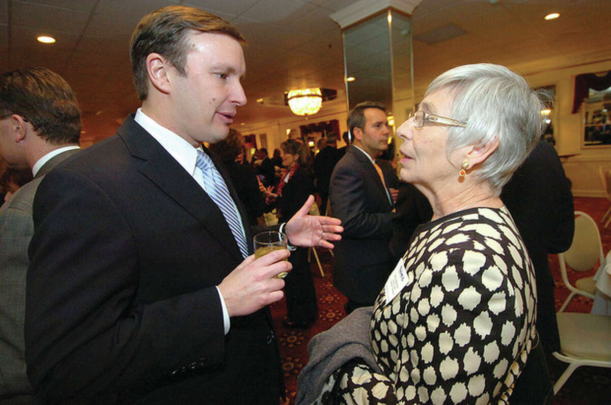 Hour Photo/Alex von Kleydorff . Senator Chris Murphy talks with Fiona Hodgson, Vice President of Development and Marketing with Fairfield County Community Foundation about Mary's Fund for Sandy Hook.