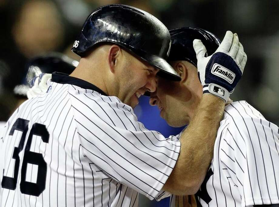 New York Yankees' Kevin Youkilis (36) congratulates teammate Brett Gardner after Gardner hit a third-inning solo home run in a baseball game against the Boston Red Sox at Yankee Stadium in New York, Thursday, April 4, 2013. (AP Photo/Kathy Willens) / AP